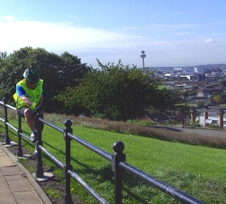 Victor climbing over the railings instead of the Bike!